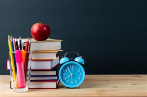 clock with apple and pencils