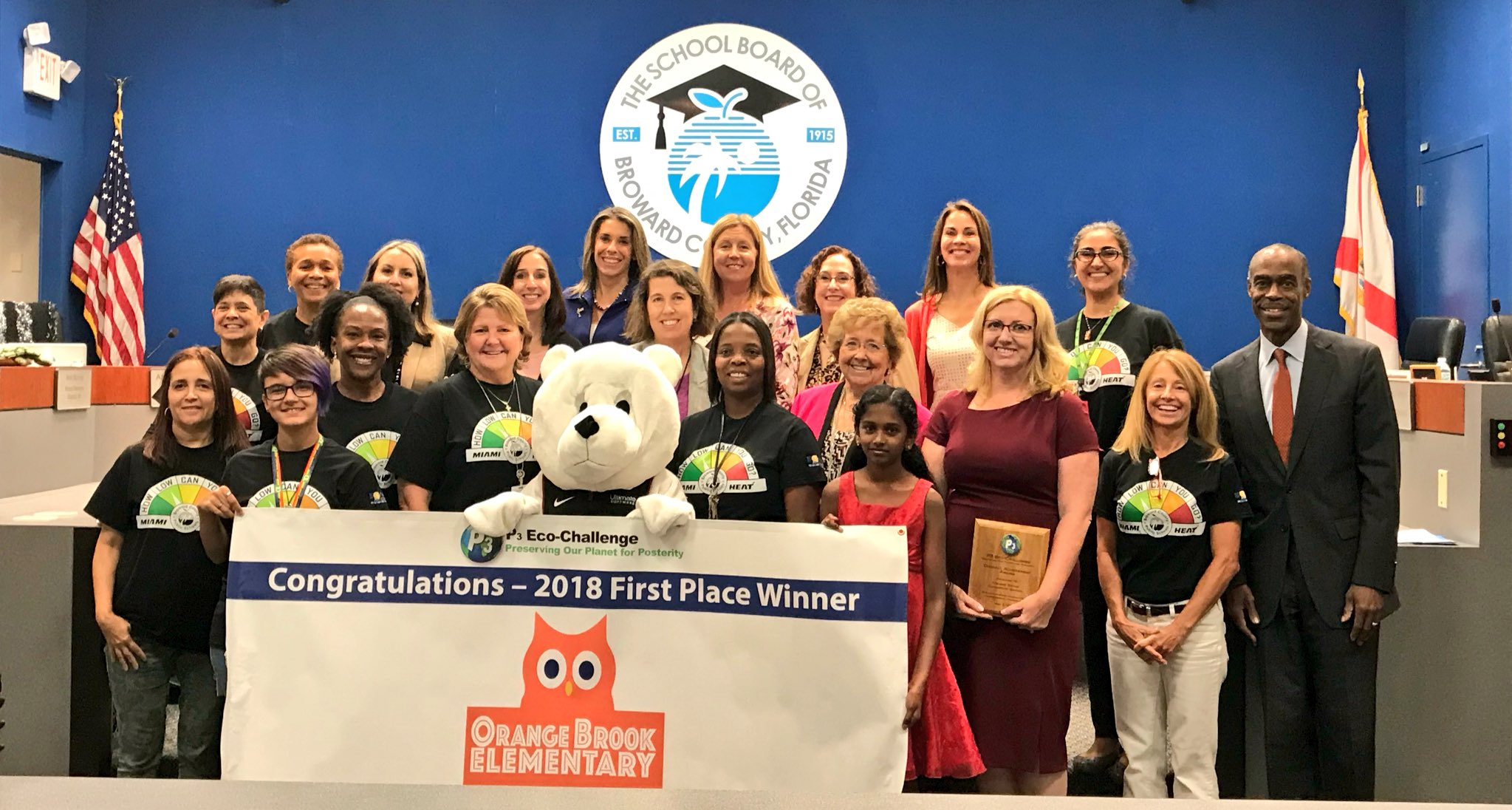 Orange Brook Elementary staff and students being presented with their winning P3 banner at a School Board meeting
