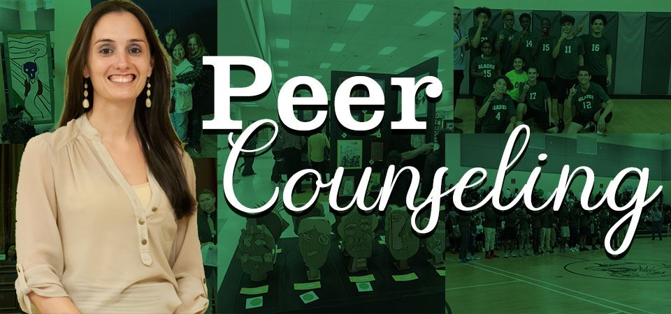 Mrs. Moser standing in front of a photomontage of student pictures with the title of Peer Counseling in the forground