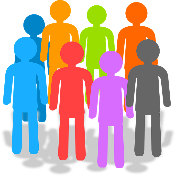 Picture of different color people standing in a group