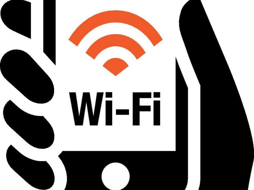 WiFi symbol on mobile device held in hand