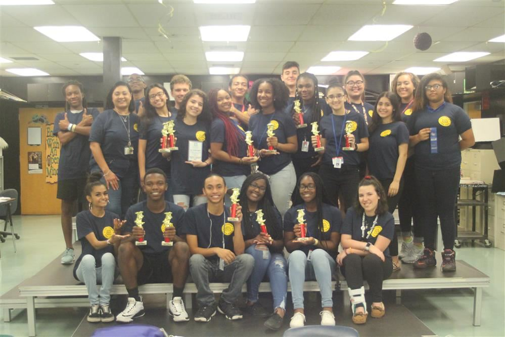 Drama Students holding Trophies