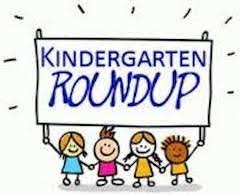kids holding kindergarten sign