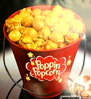 Image of red pail filled with popped popcorn