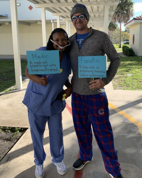 picture of DBES principal and assistant principal in the vocabulary parade