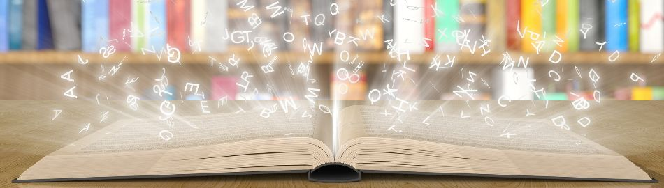 Open book with letters reflecting from the book