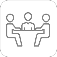 Three people sitting at a table helping